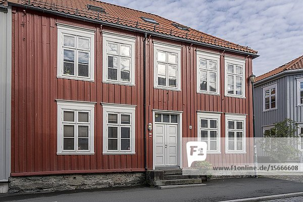 Cityscape with old red picturesque traditional house  shot under bright morning light at Trondheim  Norway.