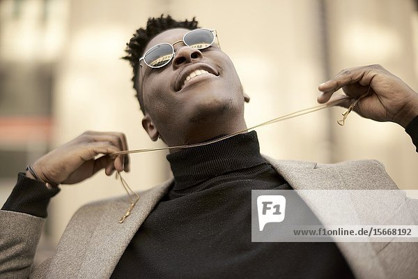 Young African man with chain in hands  in Munich  Germany.