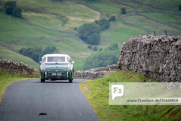 A classic Triumph TR3A drives along the rural backroads of Hawes  Yorkshire  UK.