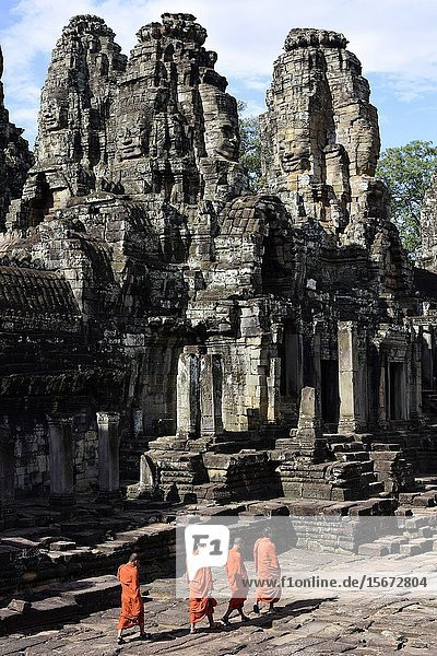 Buddhist monks in the inner part of Bayon temple Angkor Thom  Cambodia South Esat Asia.