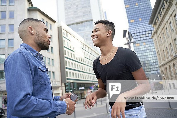 Gay couple having fun on the street. Frankfrut am Main  Germany.