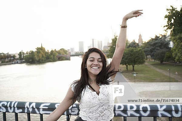 Portrait of happy young woman,  Frankfurt am Main,  Germany.