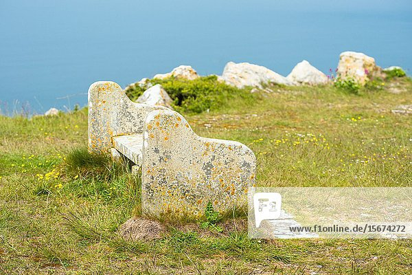 A bench on Portland Heights  made from Portland stone sourced locally from nearby quarry. Isle of Portland  Doreset  England  UK.