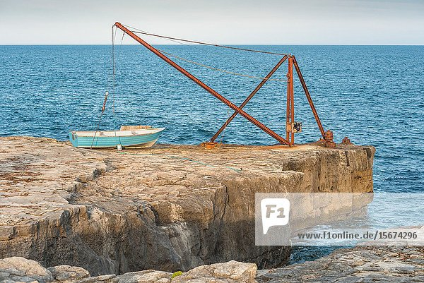 The iconic Red Crane standing on the cliff near Portland Bill lighthouse on the Isle of Portland on the Jurassic coast  Dorset  England  UK.