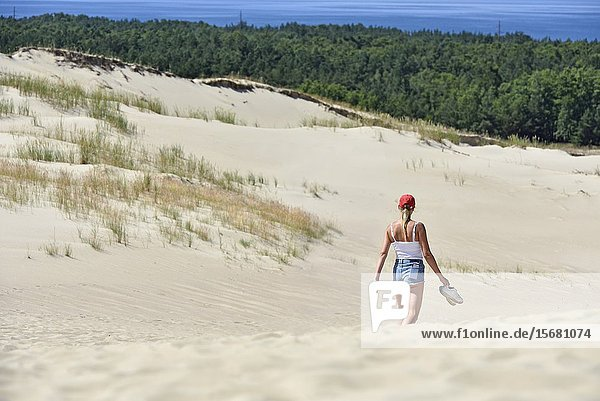 Walker in dead sand dunes  Nagliai Nature Reserve  Curonian Spit  Lithuania  Baltic States  North Europe.