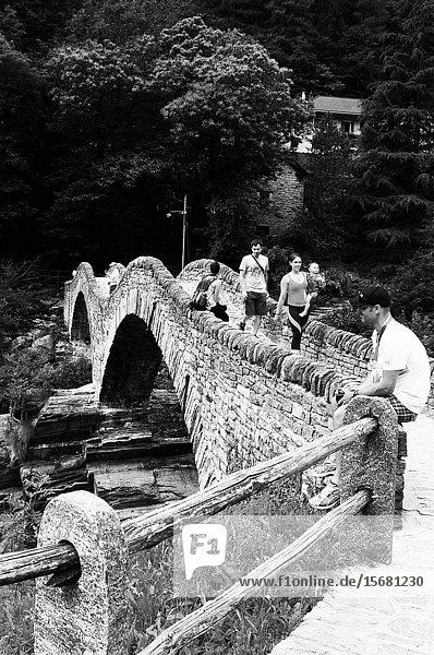 Old stone bridge over verzasca valley river in Ticino.