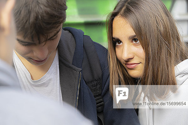 Close-up of girl looking at her friend