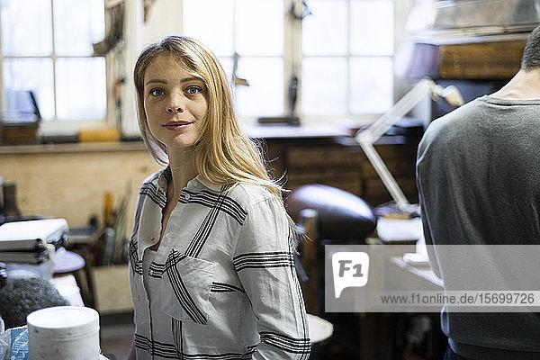 Woman standing in workshop