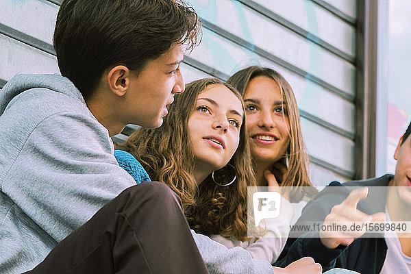 Teenage friends talking outdoors
