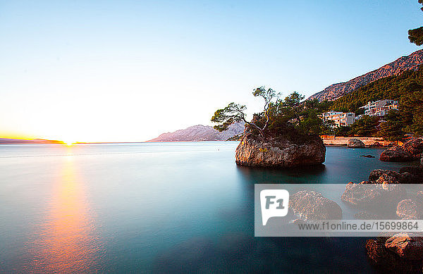 View of coastline with rocky island