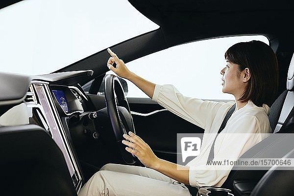 Japanese woman in self driving car