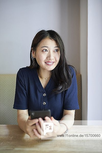 Japanese woman at a cafe