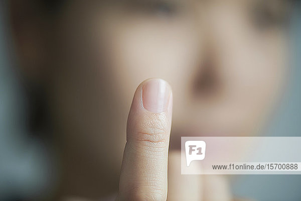 Woman pointing finger up