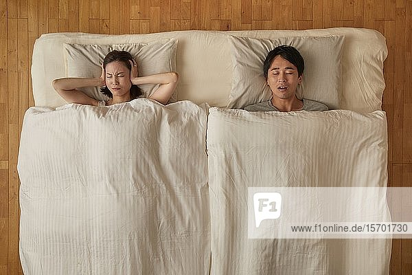 Japanese couple in bed