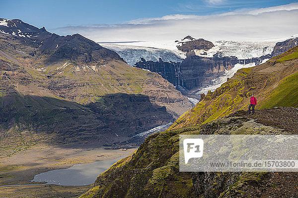 Female hiker enjoying view on peak  Skaftafell National Park  Iceland