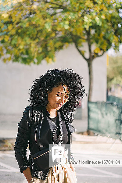 Stylish young woman looking down