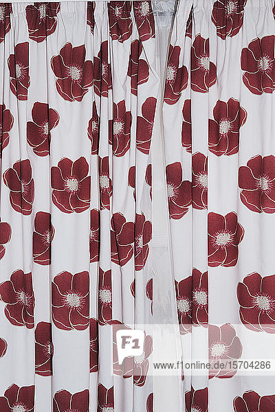 Red flowers on white curtains