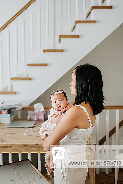 Mother with baby girl at home