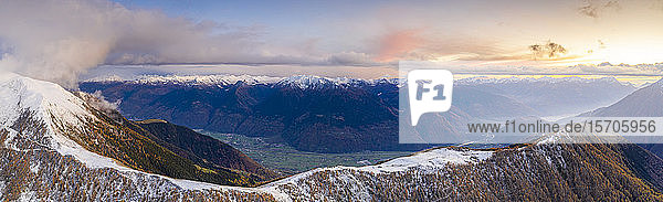 Sunset on the autumnal landscape of Scermendone Alp and Orobie Alps  aerial view by drone  Rhaetian Alps  Valtellina  Lombardy  Italy  Europe