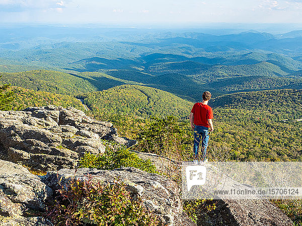 Boy looks at the view from the peak of Grandfather Mountain  Blue Ridge Mountains  Appalachia  North Carolina  United States of America  North America