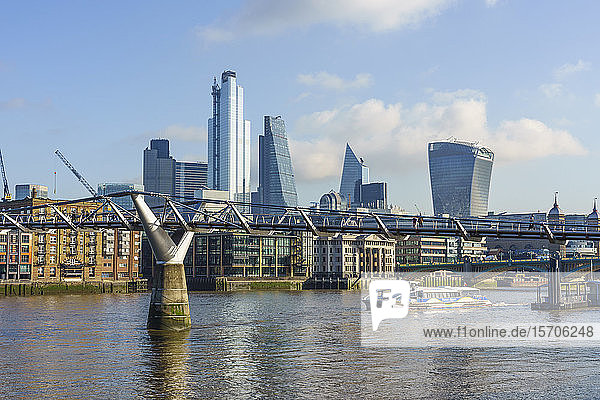 City of London skyscrapers with Millennium Bridge and River Thames  London  England  United Kingdom  Europe