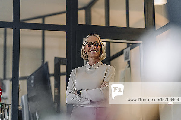Portrait of smiling mature businesswoman in office