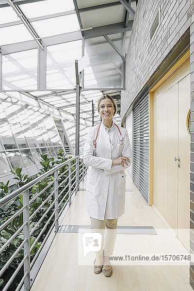 Portrait of a smiling female doctor on a passageway