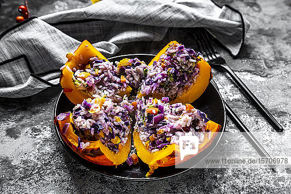 Quartered Hokkaido squash filled withrice  red cabbage  paprika  broccoli  onions and carrots