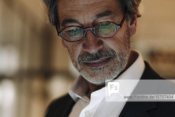 Portrait of senior businessman wearing glasses
