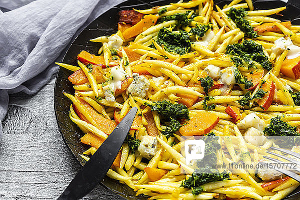 Pan of Germanschupfnudelwith pumpkin  kale and Gorgonzola cheese
