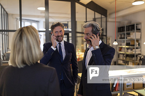 Business people on the phone in office