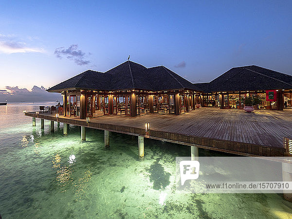 Maldives  Coastal restaurant on South Male Atoll at dusk
