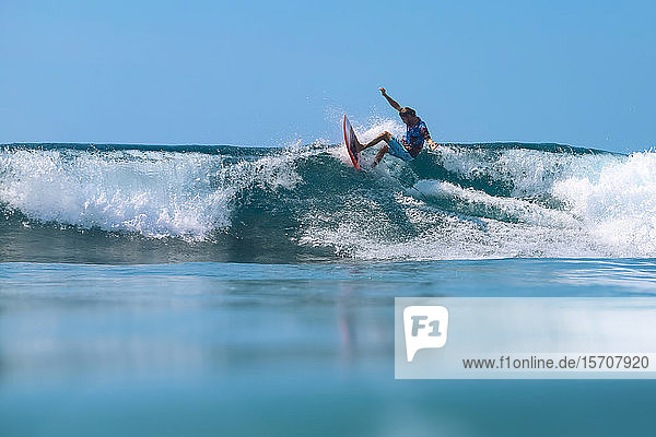 Surfer on a wave  Bali island Indonesia