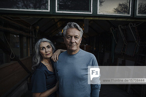 Portrait of a senior couple in a boathouse