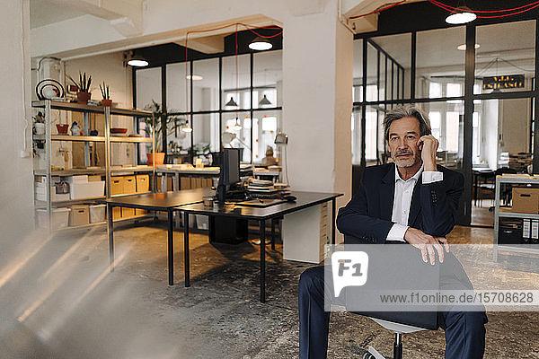 Senior businessman sitting on chair in office