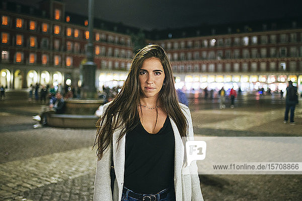Portrait of a woman standing on Plaza Mayor at night  Madrid  Spain