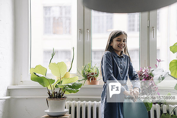 Happy girl with standing at the window in office