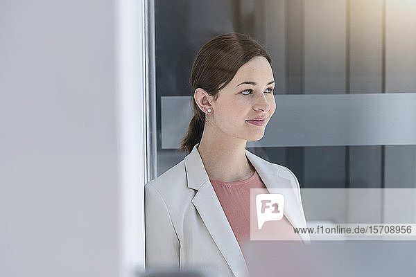 Portrait of young businesswoman having a break in office