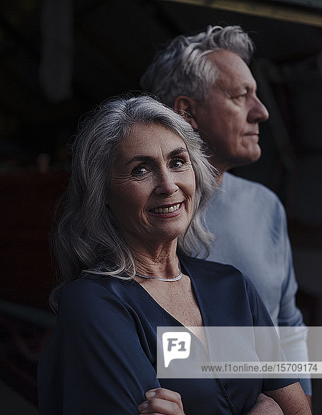 Portrait of smiling mature woman with senior husband