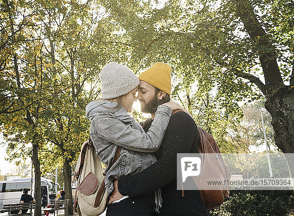 Young couple embracing in a city park  Berlin  Germany