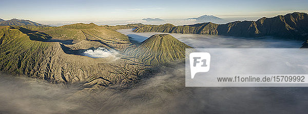 Indonesia  East Java  Aerial panorama of Mount Bromo shrouded in morning fog