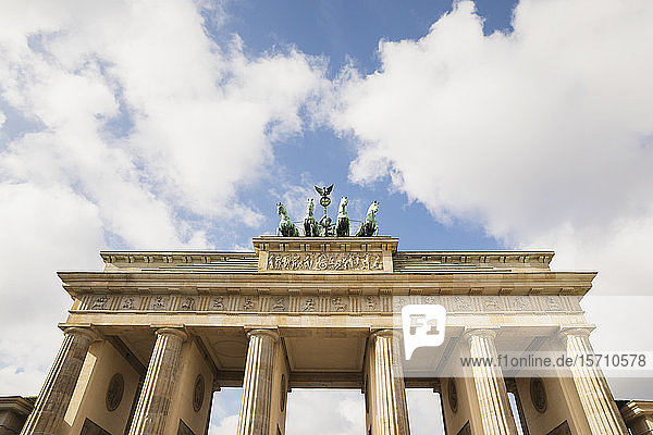 Germany  Berlin  Low angle view ofBrandenburg Gatestanding against clouds