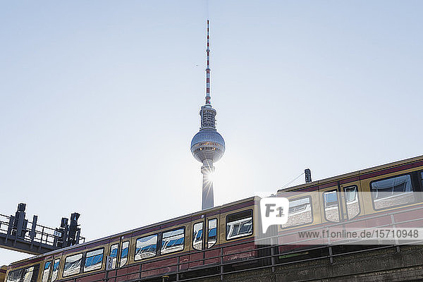 Germany  Berlin  Low angle view of TV Tower and S-Bahn train