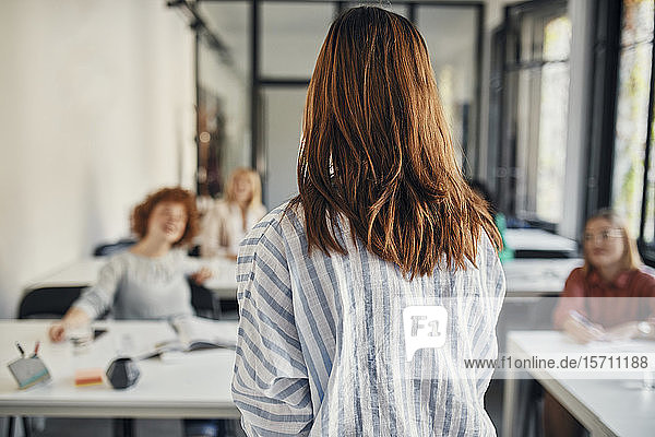Rear view of businesswoman leading a workshop in conference room