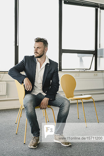 Businessman using laptop in coworking space