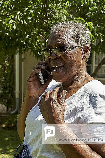 Senior woman talking on the phone outdoors