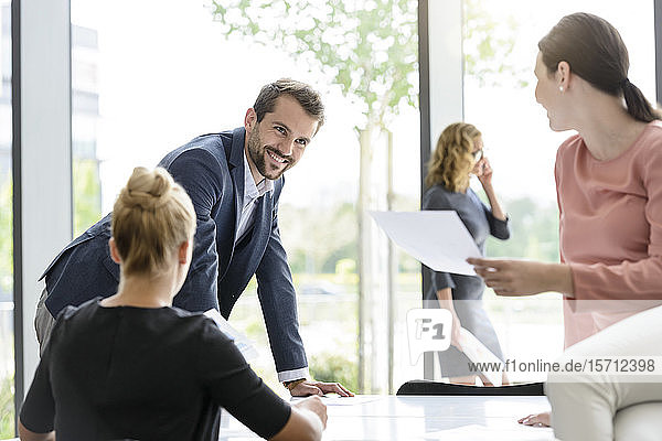 Confident business team having a meeting in office
