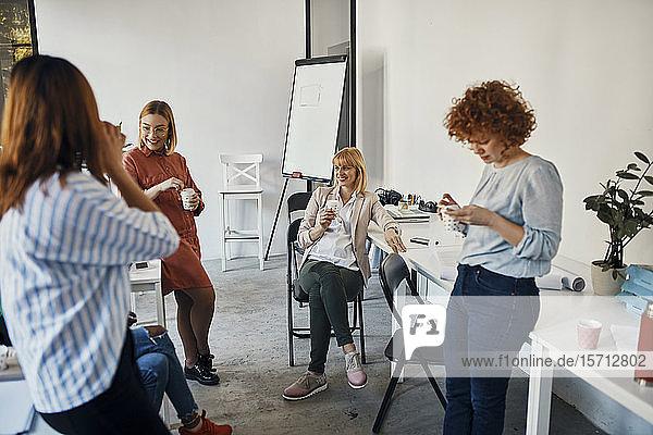 Businesswomen having a break in office