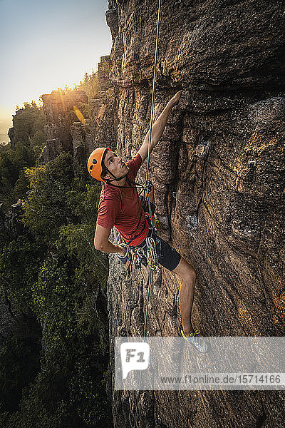 Man climbing at Battert rock at sunset  Baden-Baden  Germany
