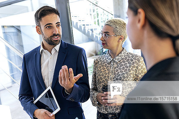 Businessman talking to colleagues in office
